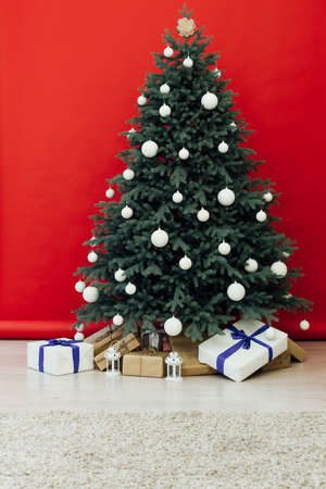Interior with blue Christmas tree with gifts for the new year decor winter red background