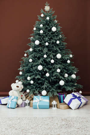 Interior with blue Christmas tree with gifts for new year decor winter brown background Stockfoto