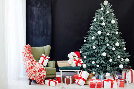 Interior with blue Christmas tree with gifts for new year decor winter black background