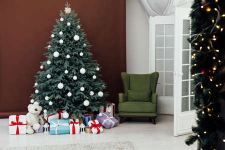 Christmas tree pine Christmas decoration interior of brown room with gifts