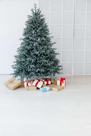 Christmas tree blue pine with gifts interior decor room New year winter holidays