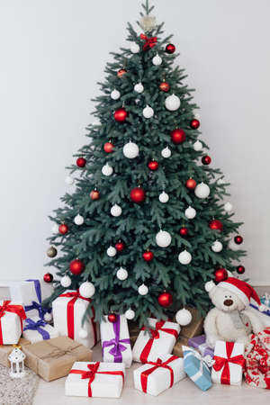 Christmas tree blue pine with gifts interior decor white room new year winter holiday 免版税图像