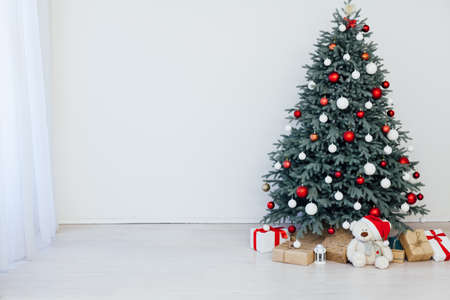 Christmas tree blue pine with gifts decor interior of the white room new year