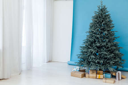 Christmas tree blue pine with gifts interior decor room New year winter holidays 免版税图像