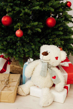 Christmas tree pine with gifts toy white soft bear