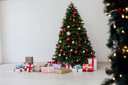 Christmas tree with gifts pine new year decor interior of the house postcard