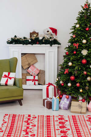 Christmas tree with gifts pine new year decor the interior of the white room of the house postcard