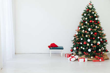 New Years Eve Christmas tree interior with holiday decor gifts Stock Photo