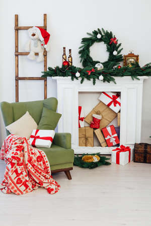 Christmas tree with fireplace interior of the house new year decor gifts