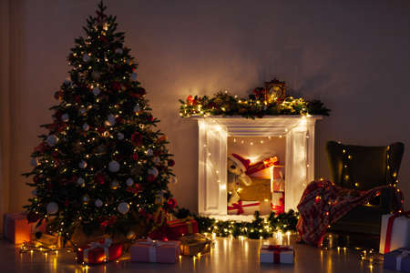 Christmas tree pine with gifts lights garland night New Years