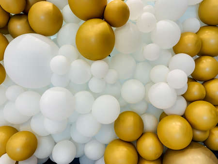 Beautiful balloons white and gold color decor on holiday as a backdrop 스톡 콘텐츠