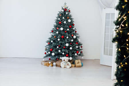 Christmas tree decor with gifts and garlands interior new year