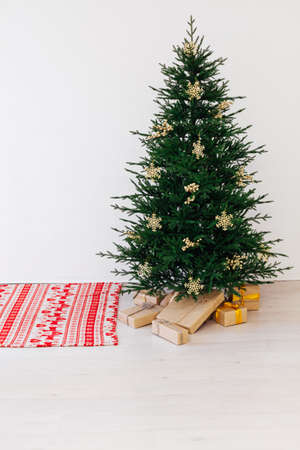 Beautiful holdiay decorated room with Christmas tree with presents under it. New year background
