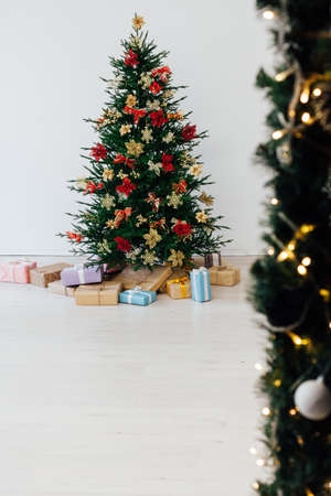 decorated room with Christmas tree with presents under it