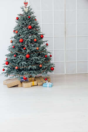 Red decor new year interior Christmas tree with gifts