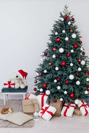 Decor new year interior beautiful Christmas tree with gifts