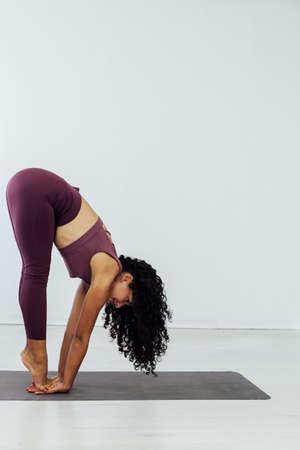 Beautiful woman yoga asana gymnastics flexibility body fitness