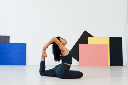 Beautiful flexible woman yoga asana gymnastics body flexibility 스톡 콘텐츠
