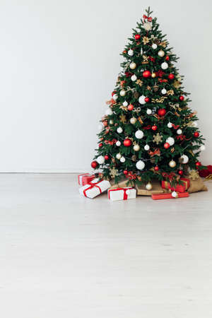 Christmas tree decor with gifts garland interior new year