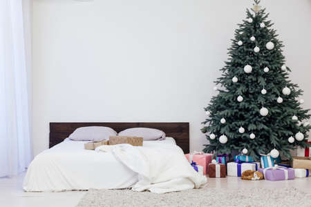 bedroom with bed New Year holiday gifts Christmas tree decor