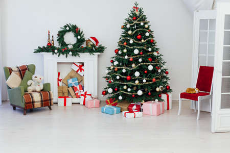 decor fireplace and Christmas tree holiday gifts new year background