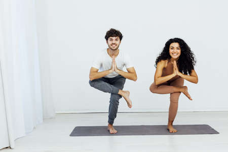 Man and woman engaged in yoga asana sports gymnastics fitness 스톡 콘텐츠 - 164449376