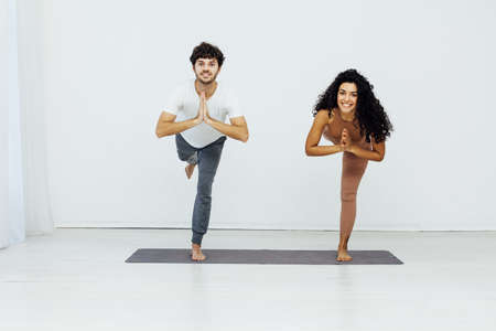 Man and woman engaged in yoga asana sports gymnastics fitness