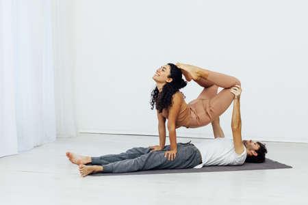 Man and woman paired family yoga asana gymnastics fitness Stok Fotoğraf
