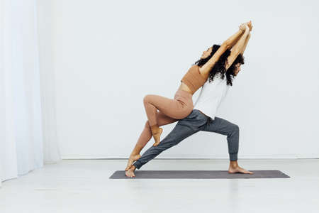 Male and female paired yoga asana gymnastics fitness