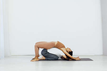 Man and woman paired family yoga asana gymnastics fitness Banque d'images