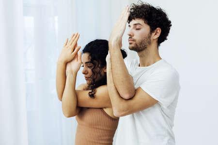 Male and female doubles yoga asana gymnastics fitness