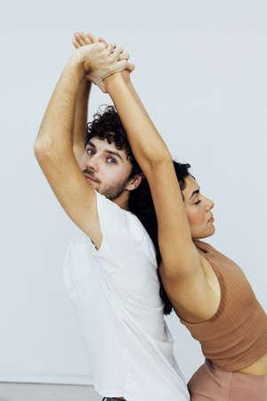 Male and female doubles yoga asana gymnastics fitness 스톡 콘텐츠 - 165617260