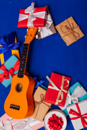 many gifts for the holiday lie in the background with the guitar