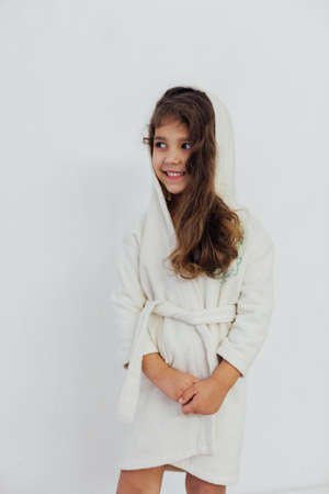 Beautiful little girl in bathrobe after bath Banque d'images