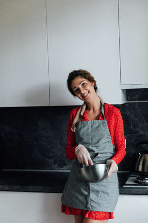 beautiful woman housewife cooks sweet delicious dessert in the kitchen Stock Photo
