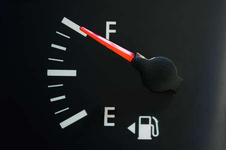 The cars fuel gauge shows a full, close-up, rough black panel. Banque d'images