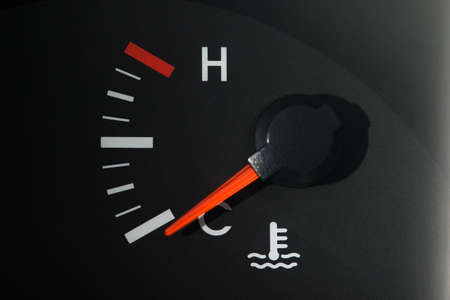 The cars coolant temperature indicator on the dashboard, a little color, shows the minimum temperature.