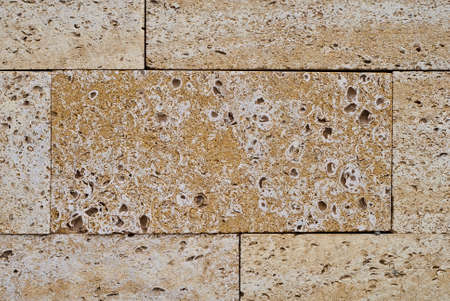 Sandstone building blocks. Rough texture of a brick wall made of sand and shells, appearance. Stock Photo