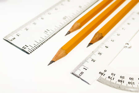 Ruler, protractor and pencils on a white background, drawing, stationery.