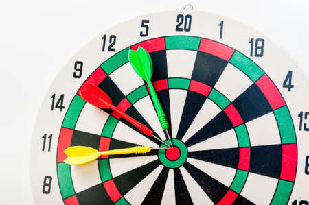 Yellow, red and green darts at the center of the target
