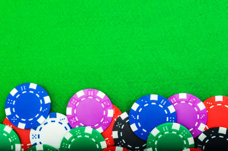 poker chips close up money on a green baize table with copy space