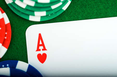 Close up of the ACE of poker chips card on the green table with copy space. High quality photo