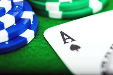 Close up of the ACE of poker chips card on the green table Archivio Fotografico