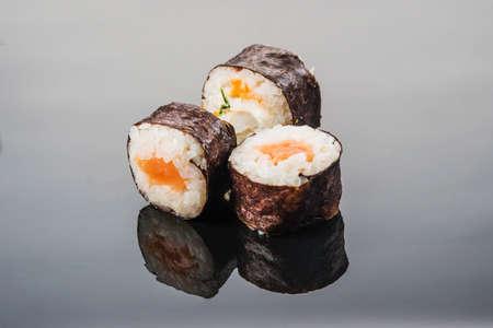 Asian cuisine, oriental rolls of raw fish and rice Archivio Fotografico
