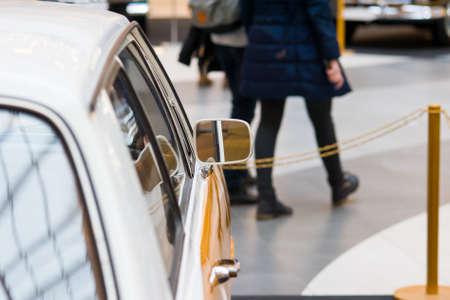 Side view of a retro car. rear view mirror, retro style