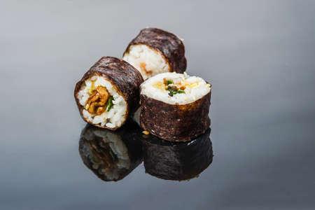 Sushi rolls of rice and raw fish, proper vegan food