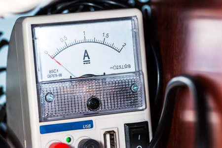 Ammeter close-up. Current, device with a white dial, electricity, measuring device, technology.