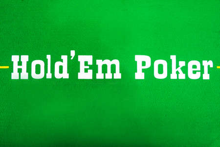 Texas Hold em lettering on the green baize of the poker table.