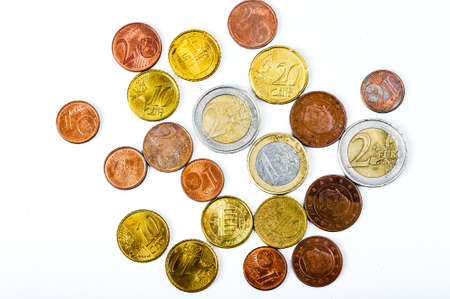 Euro coins of different denominations, taken in close-up, isolated on a white background