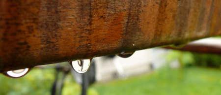 wood tick: Garden chair in rain Stock Photo